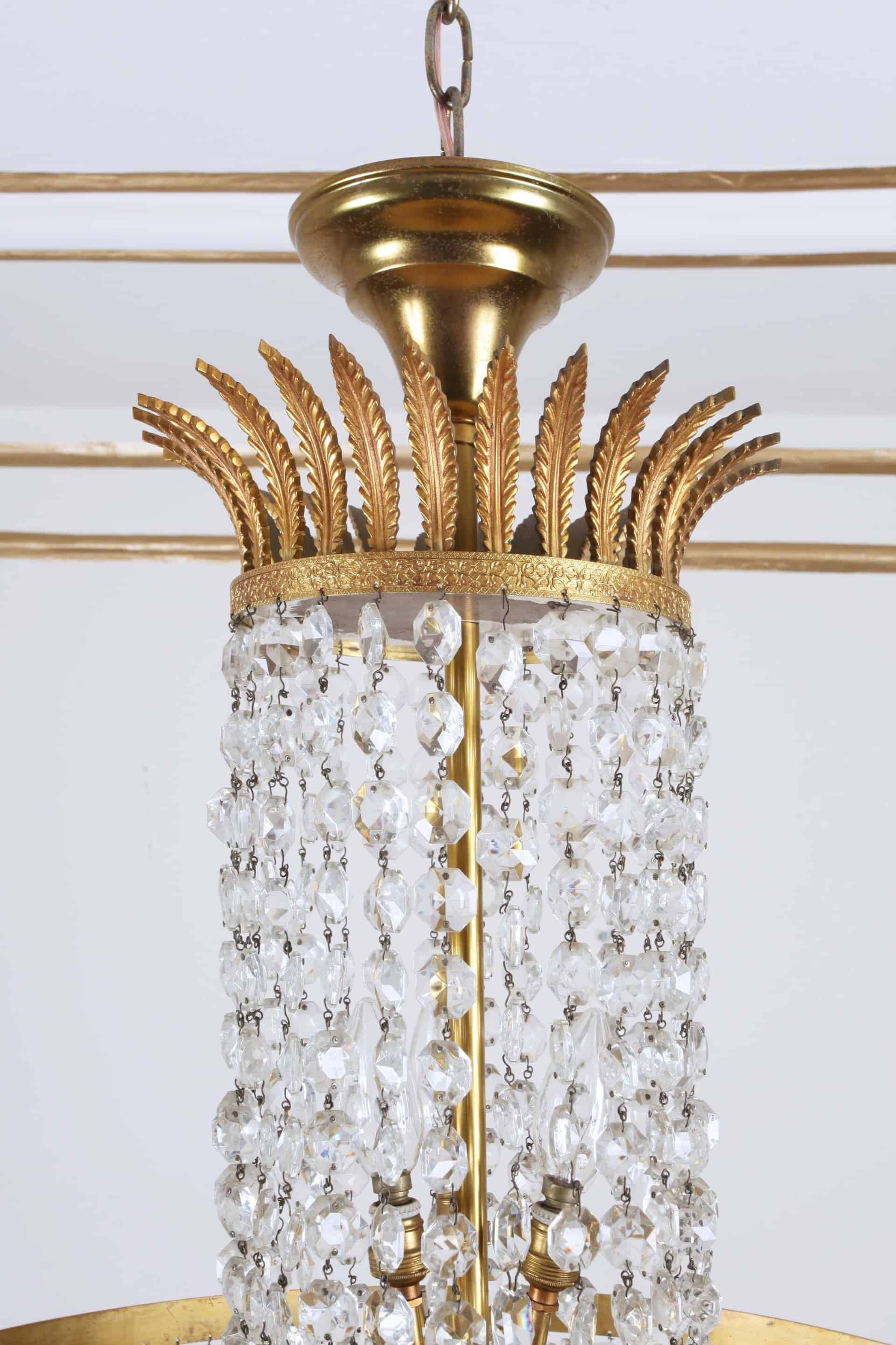 Crystal chandelier with cascading trimmings